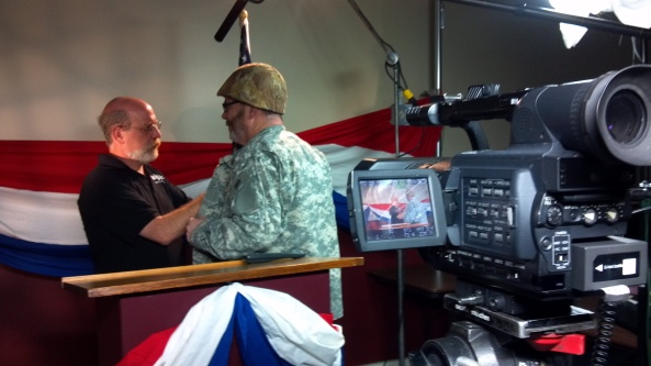 OAN Owner Bill Hyland and Media Magic's David Walker during filming of the commercial